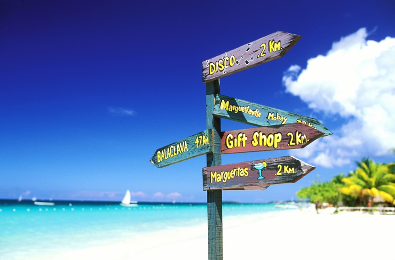 Jamaica, Westmoreland Parish, Negril, signpost on the beach