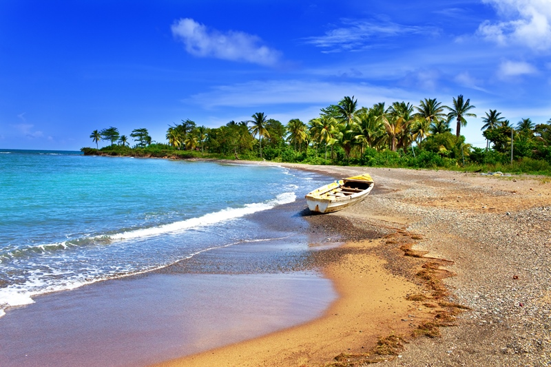 Jamaica. national boat on sandy coast of a bay